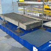 Bac de rétention souple pliable amovible installé sur chantier ou site industriel.  Zone de stockage permanente ou occasionnel