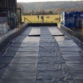 Installation de 2 bandes de roulement de 1 mètre de large chacune sur toute la longueur du bac