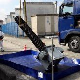 Zone de lavage pour les équipements contaminés par les particules d'amiante
